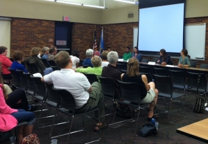 On June 17th, about 40 people listened to a panel discussion featuring volunteers and refugees.