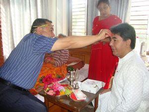 Elders putting tika  Photo courtesy of the Wikipedia Commons