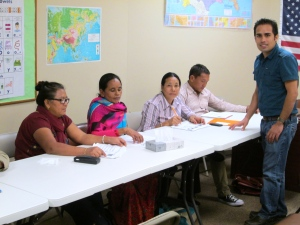 Bir working with fellow Bhutanese refugees from Nepali in Job Interview Class