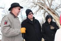 Bishop Zellmer, Rev. Stadie and Lisa Adler look over the ranch.