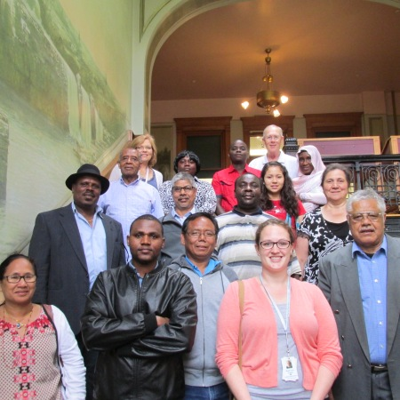 Level 3 Citizenship students are all smiles posing inside the Courthouse Museum with Instructor Mahli Garry and Volunteers Brenda Ling and Frank Boerema.