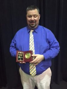 Eric with his award.