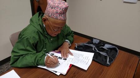 Karna Mongar, Age 91, Working on his English Literacy Skills