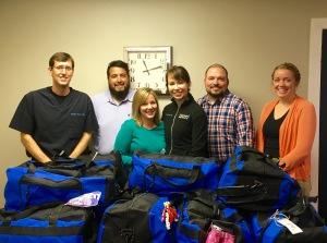 LSS Staff Josh Harris, Jessica Lillebo, Mark Kiepke, and Beth Braun accept the Sweet Cases