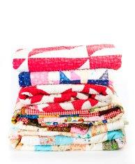 stack-of-colorful-old-quilts-picture-id468320545