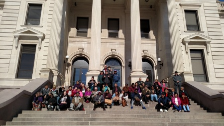 students enjoy the sunshine on the capitol steps