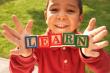 ist1_6456892-boy-holding-word-learn